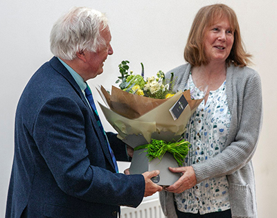 Lis Greeves presented with flowers by Peter Beacham